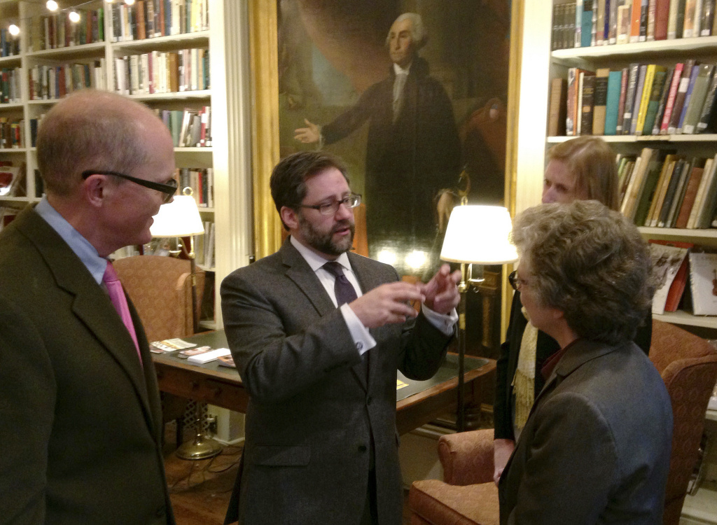 Jon Parrish Peede, center, acting head of the National Endowment for the Humanities, speaks with people from local cultural organizations during a reception in Nov. 2017 in Providence, R.I.