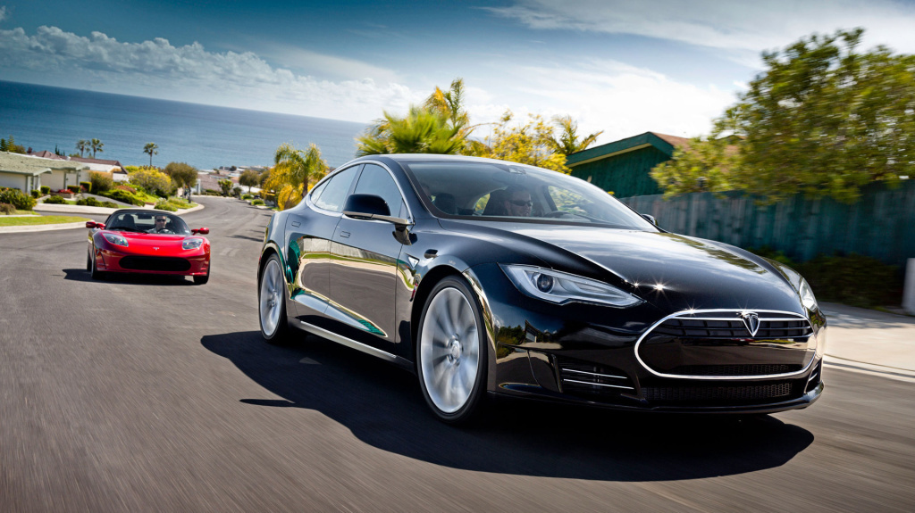 Tesla Motors has outsold several luxury carmakers in California in 2013, on the strength of its Model S, seen here in the foreground. The Telsa Roadster is behind it.