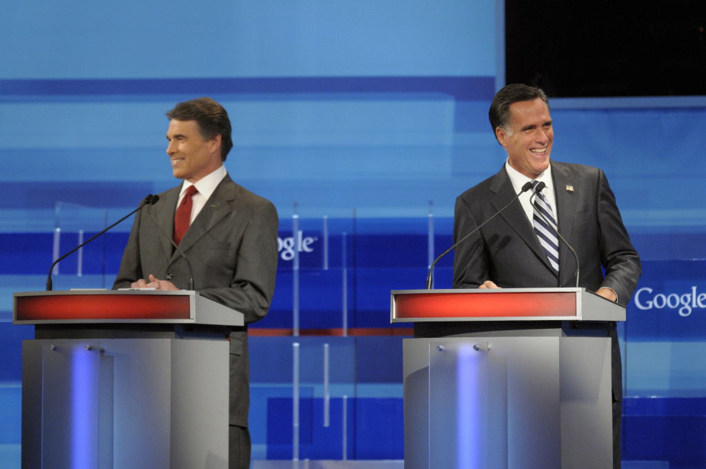 Republican presidential candidates, Texas Gov. Rick Perry (L) and former Massachusetts Gov. Mitt Romney laugh during the Fox News/Google GOP Debate at the Orange County Convention Center on Sept. 22 in Orlando, Florida. They'll face off again in New Hampshire, Oct. 11.