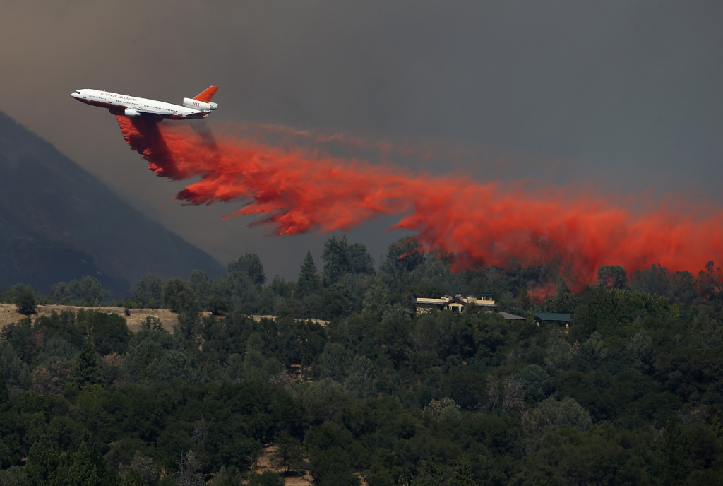 A DC-10 air tanker drops fire retardant on a ridge ahead of the advancing Rim Fire on August 22, 2013 in Groveland, California. Federal foresters are preparing for a bad fire season with a budget that might run dry and a fleet of air tankers that in some cases aren't ready for takeoff.