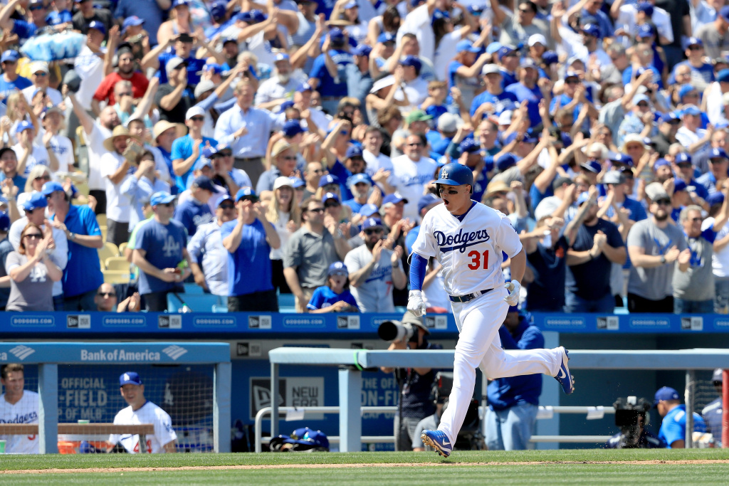 LOS ANGELES, CA - APRIL 03:  Joc Pederson #31 outfield the Los Angeles Dodgers approaches home plate after hitting a grand slam during the third inning of an Opening Day game against the San Diego Padres  at Dodger Stadium on April 3, 2017 in Los Angeles, California.  (Photo by Sean M. Haffey/Getty Images)