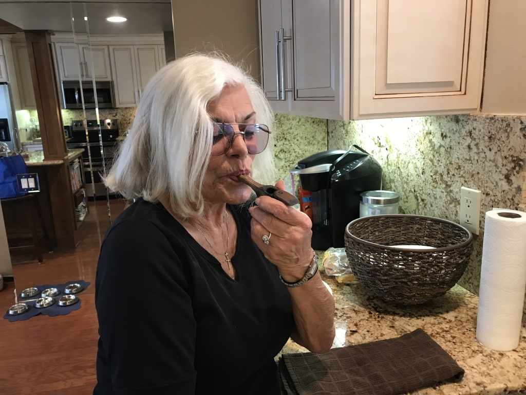Linda Tisbo, a member of the Laguna Woods Medical Cannabis Collective, cleans out her pipe on April 11, 2018. The collective has more than 800 members.