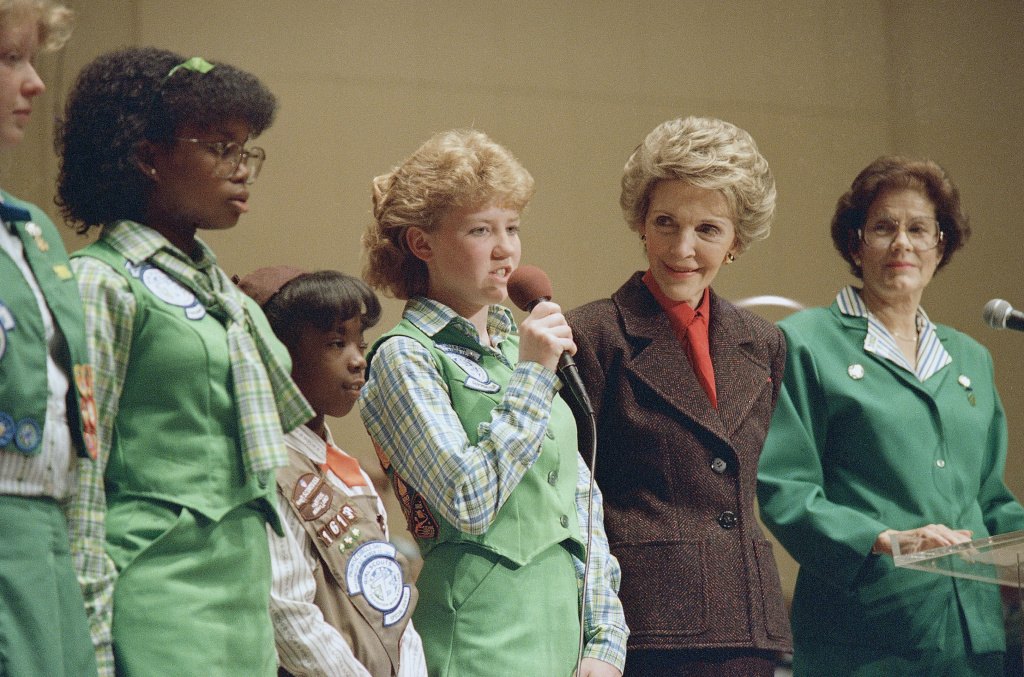 In this March 12, 1987 file photo, Brownie Girl Scout Kristy Miller, 7, from Glen Burnie, Md., recites the Pledge of Allegiance during ceremonies commemorating the 75th year of the Girl Scouts in Washington. First lady Nancy Reagan is at second left.
