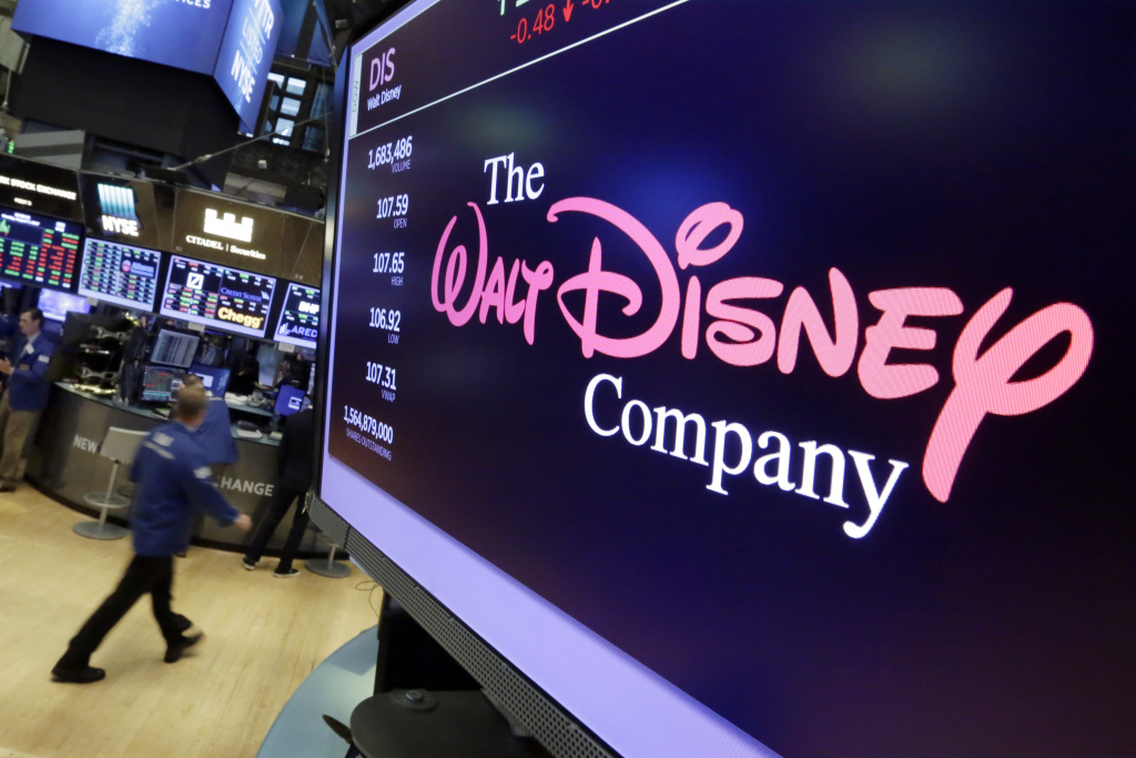 In this Monday, Aug. 7, 2017 file photo, The Walt Disney Co. logo appears on a screen above the floor of the New York Stock Exchange.