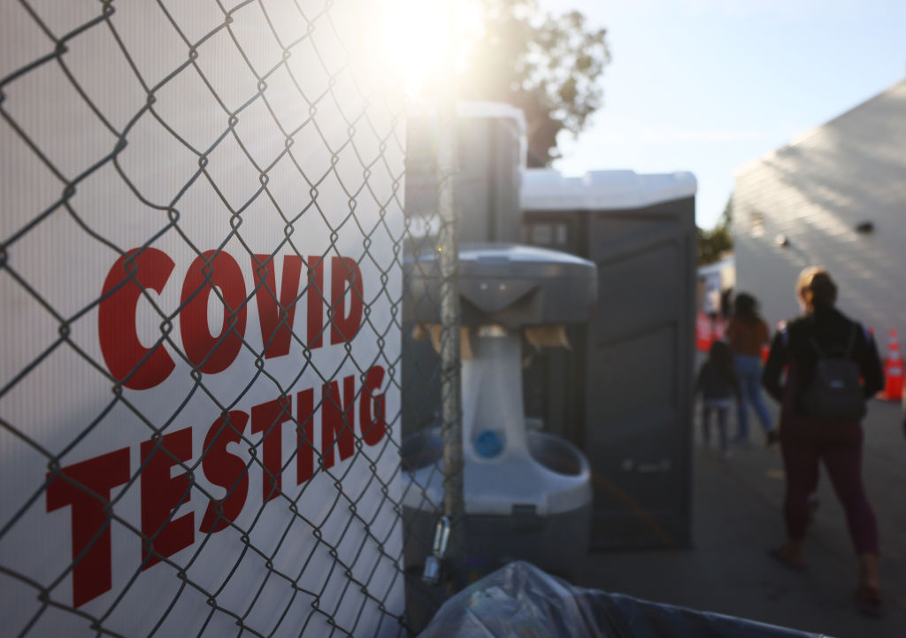 People walk to enter a COVID-19 testing site on December 2, 2020 in San Fernando, California.