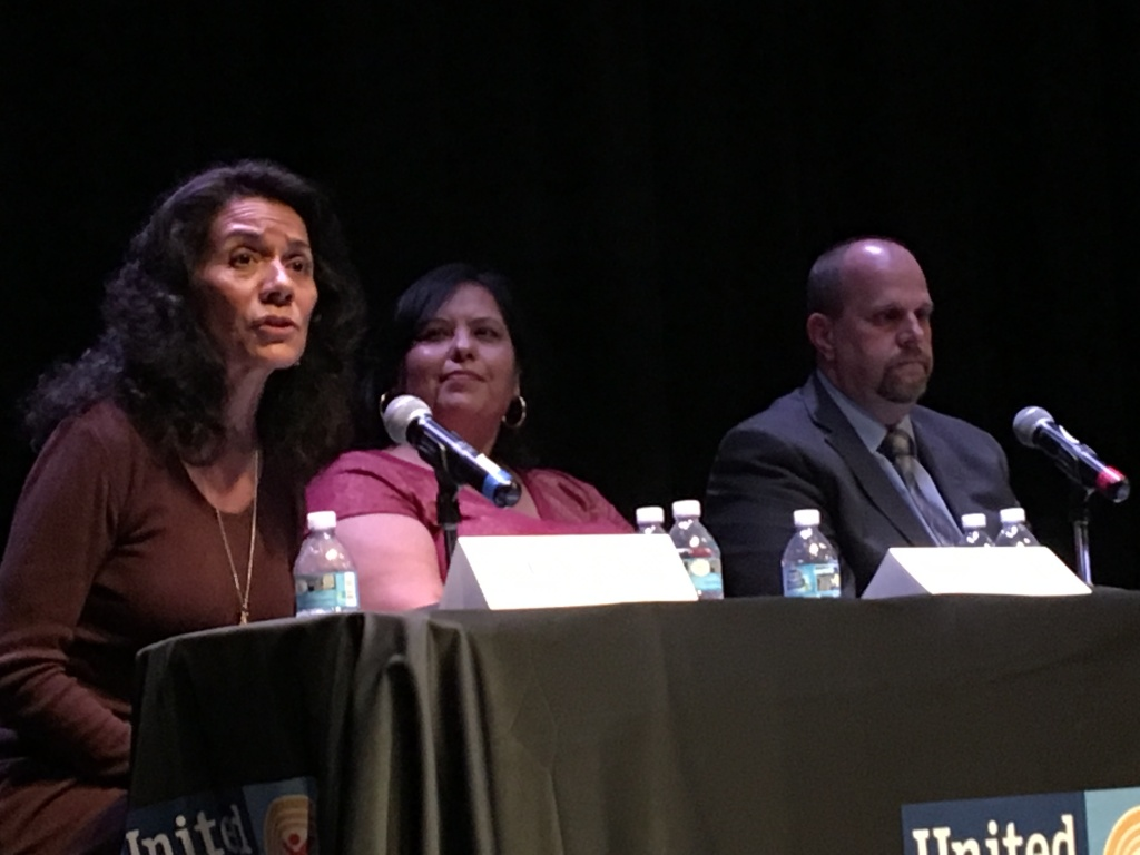 Los Angeles Unified School Board candidate Lisa Alva (left) speaks during a forum for candidates in District 2, which covers central and east L.A., as incumbent Mónica García (center) and candidate Carl Petersen sit nearby.
