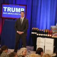 A security agent stands near a display of products that Republican presidential candidate Donald Trump has for guests, including meat, wine and water before a press conference at the Trump National Golf Club Jupiter on March 8, 2016 in Jupiter, Florida.