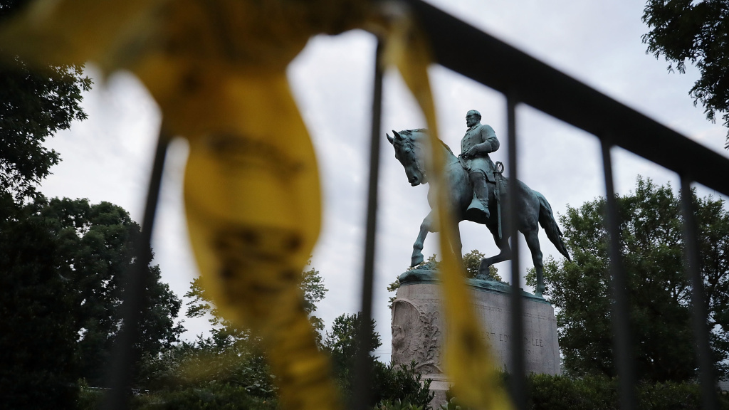 The statue of Confederate Gen. Robert E. Lee stands in the center of Emancipation Park the day after violence broke out in Charlottesville, Va. The