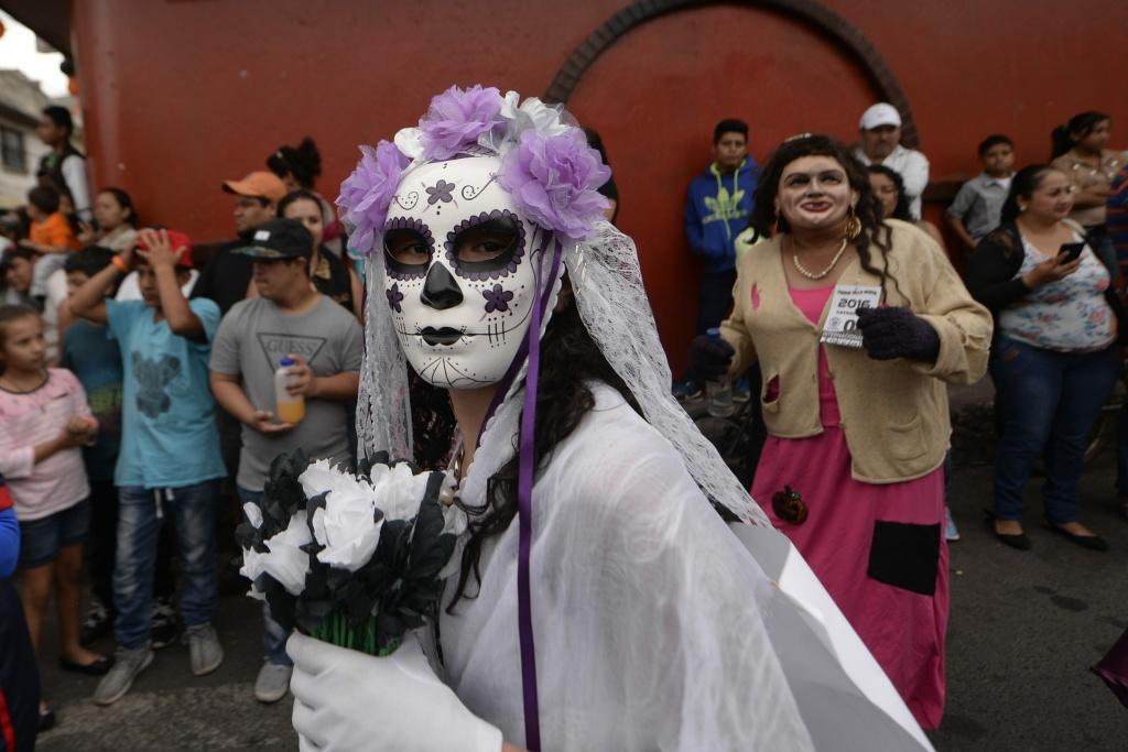 d4abf99fb3e A woman dressed as Catrina takes part in the traditional Convite de fieros  festival