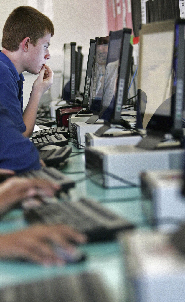 Students use the internet at Bridgemary Community School on November 7, 2005 in Gosport, England.