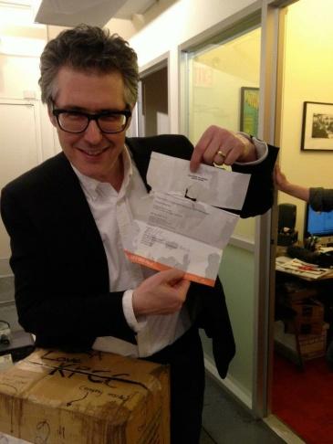Host Ira Glass celebrates the