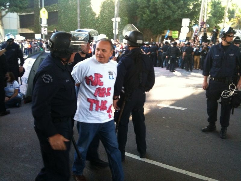 An Occupy protester being arrested following a planned disobedience, blocking traffic at Figueroa and Fourth in downtown Los Angeles.