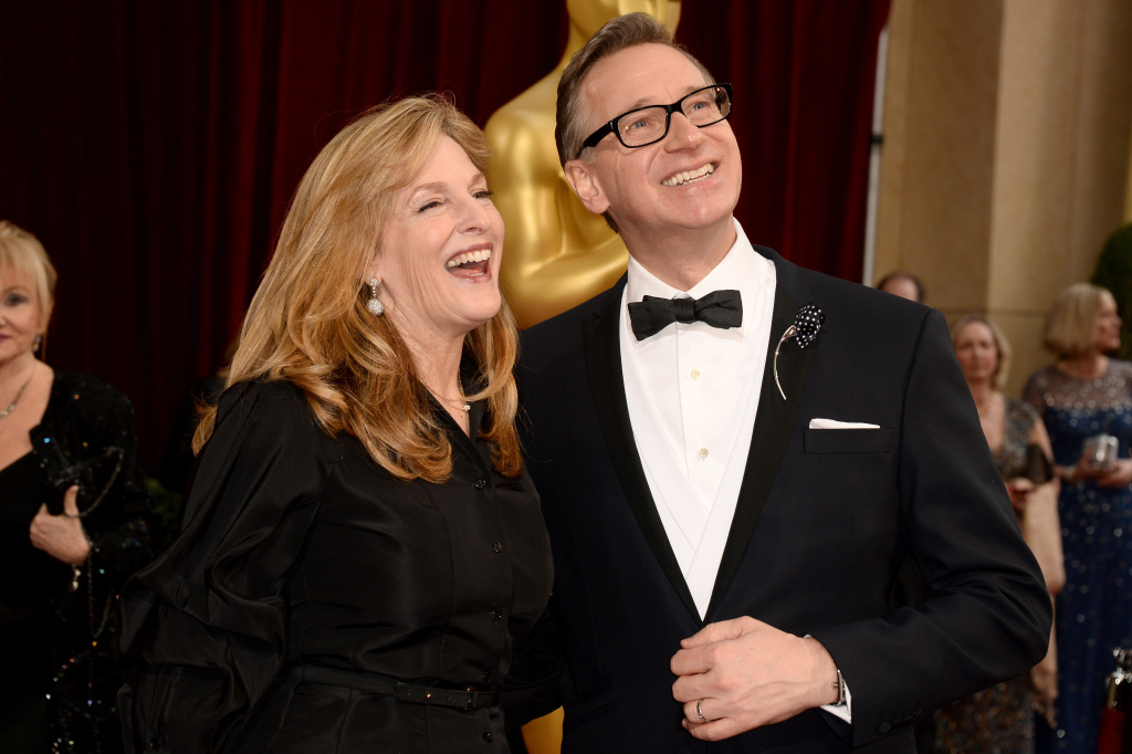 Director Paul Feig (R) and wife Laurie Karon attends the Oscars held at Hollywood & Highland Center on March 2, 2014 in Hollywood, California.