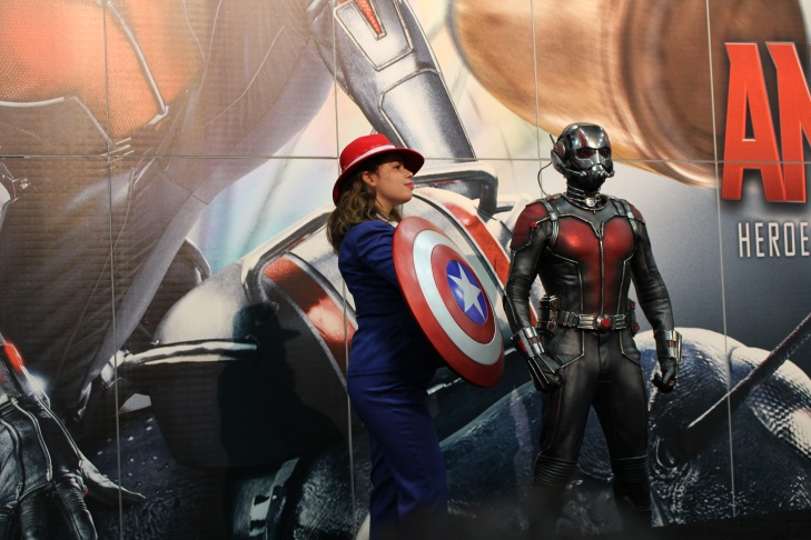 An Agent Carter cosplayer posing with an Ant-Man statue at San Diego Comic-Con 2015.