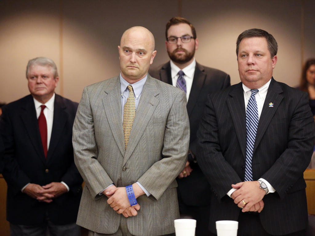 Former Balch Springs Police Officer Roy Oliver, foreground left, stands next to defense attorney Miles Brissette, right, after being sentenced to 15 years in prison for the murder of 15-year-old Jordan Edwards, on Wednesday.