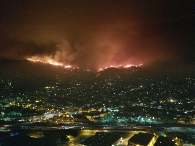 The La Tuna Canyon fire burns in the hills above Burbank, California, early Sept. 2, 2017.