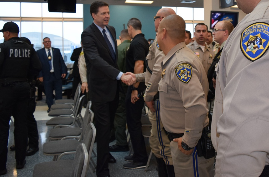 FBI Director James Comey meets with law enforcement in San Bernardino on Tuesday, Dec. 22, 2015.