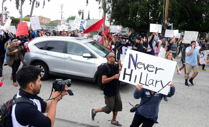 Protesters from Latino and Community groups make their way to East Los Angeles College in Monterey Park on May 5, 2016 to protest U.S. Democratic presidential candidate Hillary Clinton. Clinton campaigned in the Los Angeles area ahead of California's June 7 primary.