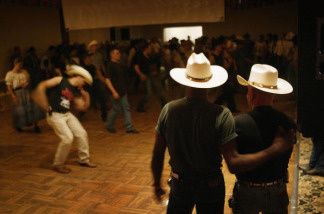 Cowboys dance with one another on the eve of the gay-oriented 16th Annual San Diego Rodeo on September 17, 2004 in Del Mar, California. The San Diego Rodeo is put on by the Golden State Gay Rodeo Association (GSGRA), one of four founding associations of the International Gay Rodeo Association (IGRS).