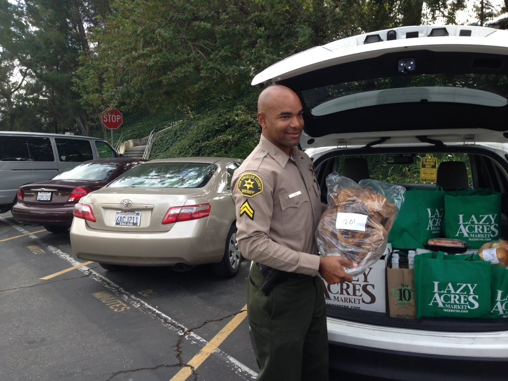 Deputy Justin Cham packs his car full of Thanksgiving dinners destined for the families of sheriff's employees deployed in Iraq.