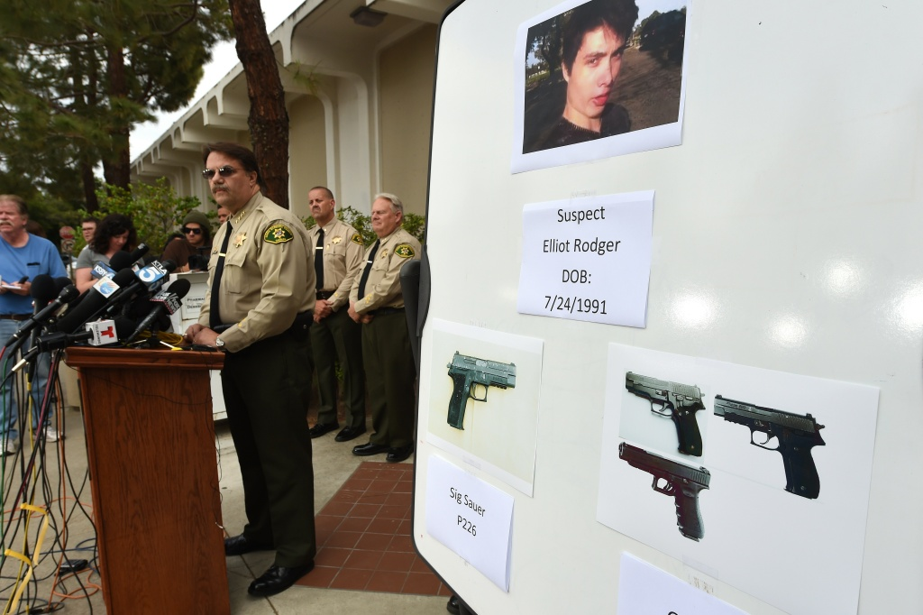 Santa Barbara County Sheriff Bill Brown identifies murder suspect Elliot Rodger (photo right) and some of the weapons he used, at a press conference in Goleta, California May 24, 2014. Rodger, 22, went on a rampage in Isla Vista near the University of California at Santa Barbara campus, stabbed three people to death at his apartment before shooting to death three more in a terrorizing crime spree through the neighborhood.