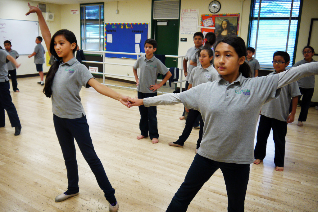Gabriella Charter School students in teacher Courtney Alexander's class practice jazz moves that incorporate samba techniques.