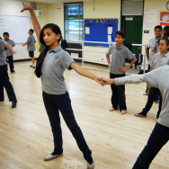 File: Fifth-grade students at Gabriella Charter School practice jazz moves that incorporate samba techniques.