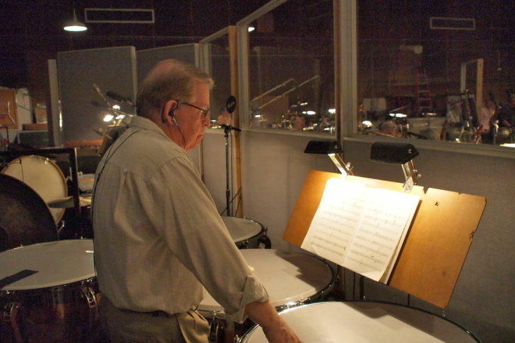 Composer Michael Giacchino going over the sheet music for the John Carter film score as it's being recorded