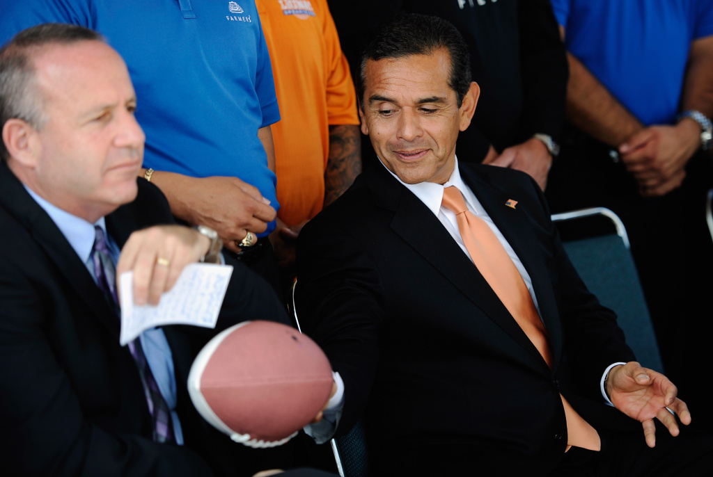Los Angeles Mayor Antonio Villaraigosa (R) passes a Farmers Field football to State Senate President Pro Tem Darrell Steinberg, (D-Sacramento) during an event where Gov. Jerry Brown signed two bills at the site of a proposed new stadium. Sources told Yahoo! Sports that Villaraigosa requested a meeting on Dec. 18 between the NFL and AEG, hoping billionaire developer Phil Anschutz would show more interest in the stadium.