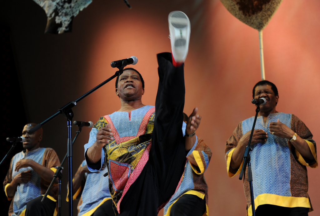 DURBAN, SOUTH AFRICA - JULY 05:  Ladysmith Black Mambazo performs during the opening ceremony of the 123rd IOC session on July 5, 2011 in Durban, South Africa. The annual general meeting of the members of the International Olympic Committee held in Durban will decide on Wednesday, July 6, 2011, which of the three candidate cities, Munich, Annecy and PyeongChang, will host the 2018 Olympic Winter Games.  (Photo by Jasper Juinen/Getty Images)
