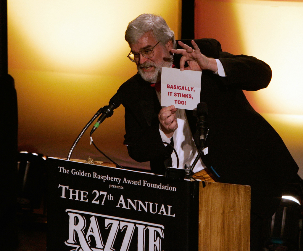"Presenter John Wilson announces the winner for  ""Worst Picture"",  ""Basic Instict 2"" announced as ""Basically it Stinks Too"" during the Razzie Awards in Hollywood, CA, 24 February 2007. The ""Razzie"" a gold-spray-painted, golf-ball-size raspberry atop of a mangled super 8 film reel trophy, with an estimated street value of 4.97 dollars, awards the worst movie and actors Hollywood produced during the year. The 2007 winners included, Sharon Stone for Worst Actress, ""Lady in the Water"" for Worst Picture and its director Night Shyamalan as Worst Director."