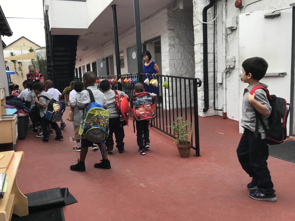 Students dropped their backpacks off on the first day of school at Crete Academy, a new charter targeting homeless students in South L.A.