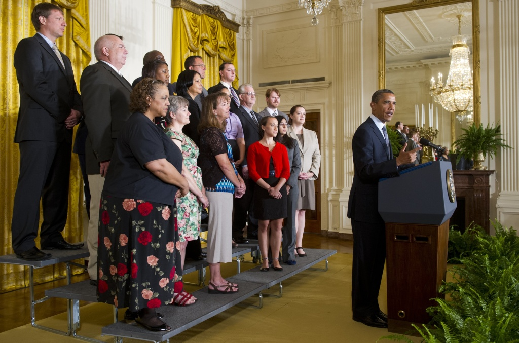 US President Barack Obama speaks about urging the US Congress to act on extending tax cuts for middle class families alongside individuals who will benefit from the extension of the tax cuts, in the East Room of the White House in Washington, DC on July 9, 2012.