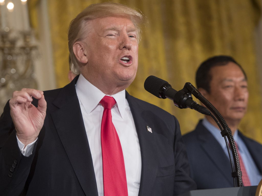 President Trump speaks at the White House alongside Foxconn Chairman Terry Gou during an announcement last July that the electronics supplier will open a manufacturing facility in Wisconsin.
