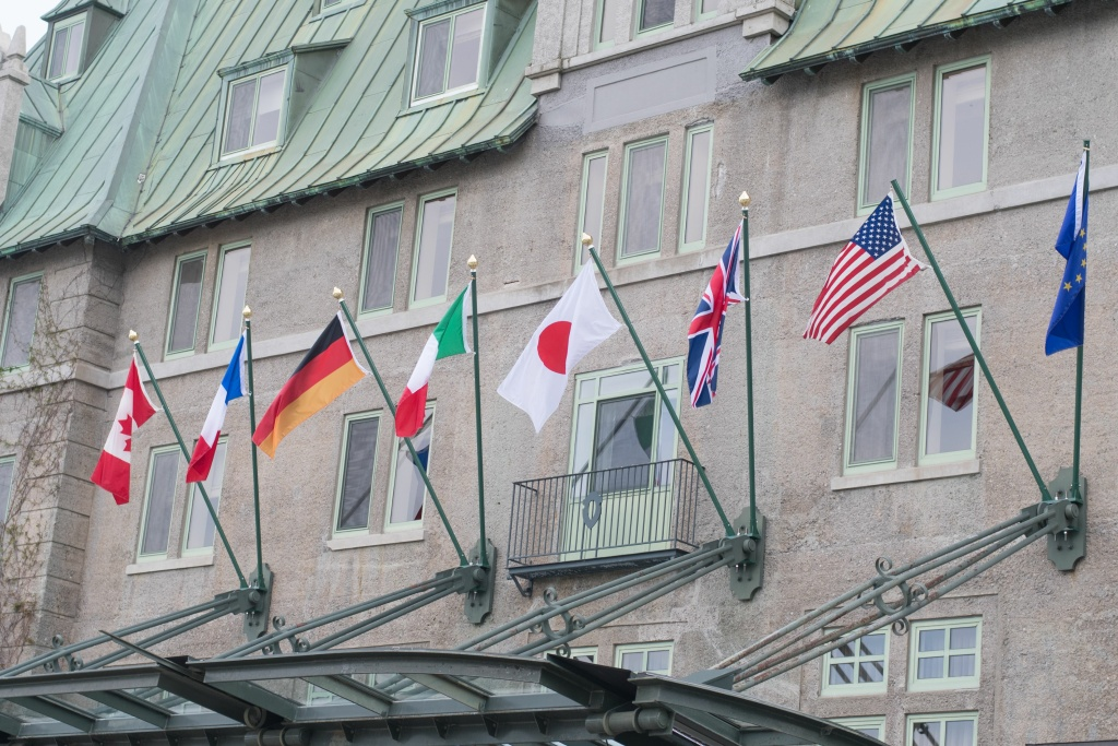 Flags fly over the Fairmont Le Manoir Richelie hotel, the location for the G7 summit, in La Malbaie, Quebec on June 1, 2018.