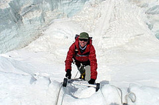 Cal State Fullerton lecturer Cindy Abbott climbs through the Khumbu Icefall.