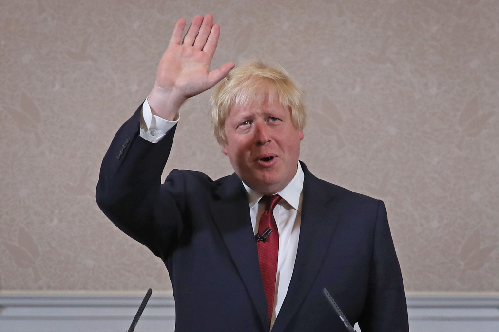 Former London Mayor and Conservative MP Boris Johnson waves as he ...