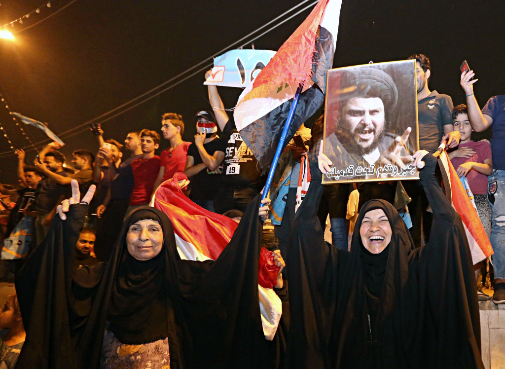 With official results in from just over half of the country's provinces, supporters of current frontrunner, the influential Shiite cleric Muqtada al-Sadr, celebrate in Tahrir Square, Baghdad, early Monday.