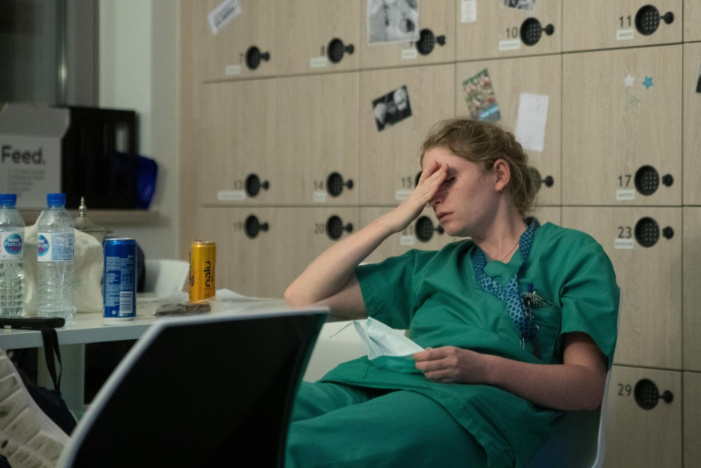 Mathilde Dumont, a 27-year-old nurse, reacts to tiredness early on April 11, 2020, during her night shift in the intensive care unit exclusively for COVID-19 patients at the Ixelles Hospital in Brussels, amid the COVID-19 pandemic, caused by the novel coronavirus.