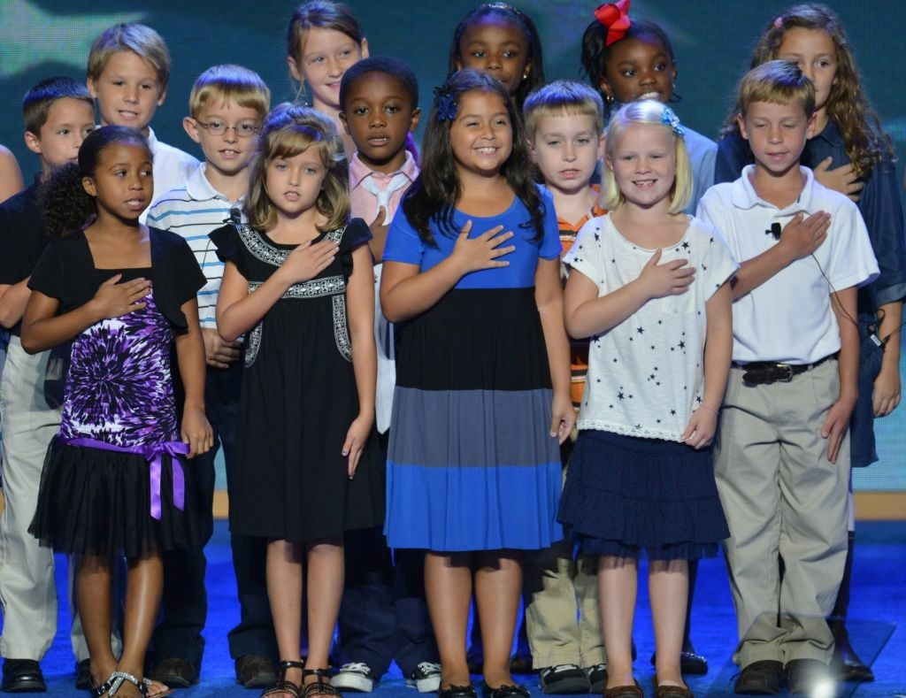 The 3rd Grade Class, W.R. O'Dell Elementary School from Concord, North Caroline, pledges allegiance at the Time Warner Cable Arena in Charlotte, North Carolina, on September 4, 2012 on the first day of the Democratic National Convention (DNC). The DNC is expected to nominate US President Barack Obama to run for a second term as president.