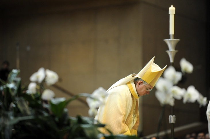 Archbishop Jose Gomez bows his head during a Ceremony of Transition as Archbishop at the Cathedral of Our Lady of the Angels.