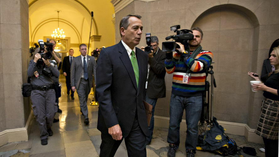 House Speaker John Boehner of Ohio arriving on Capitol Hill on Tuesday as legislation to negate a fiscal cliff of across-the-board tax increases and sweeping spending cuts moved to the GOP-dominated House.