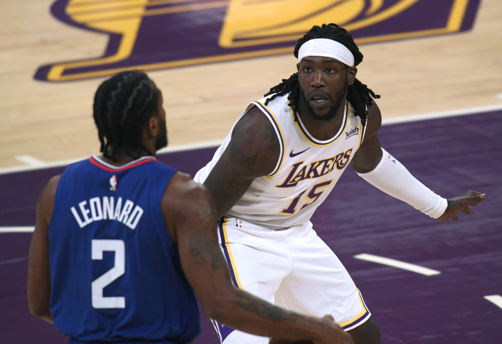 Montrezl Harrell #15 of the Los Angeles Lakers defends Kawhi Leonard #2 of the LA Clippers during a preseason game at Staples Center on December 13, 2020 in Los Angeles, California.