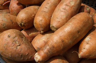 Sweet potatoes are seen for sale at a 'farmers market' June 3, 2010, in downtown Washington, DC.