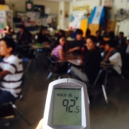 Spanish teacher Karla Johnson takes the classroom temperature at Franklin High School in L.A.'s Highland Park. She says she's been complaining about faulty air conditioning for 10 years.
