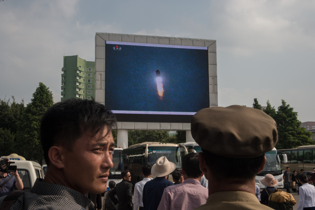 A screen shows news coverage of an August 29 missile test launch in a public square outside a train station in Pyongyang, North Korea on August 30, 2017.