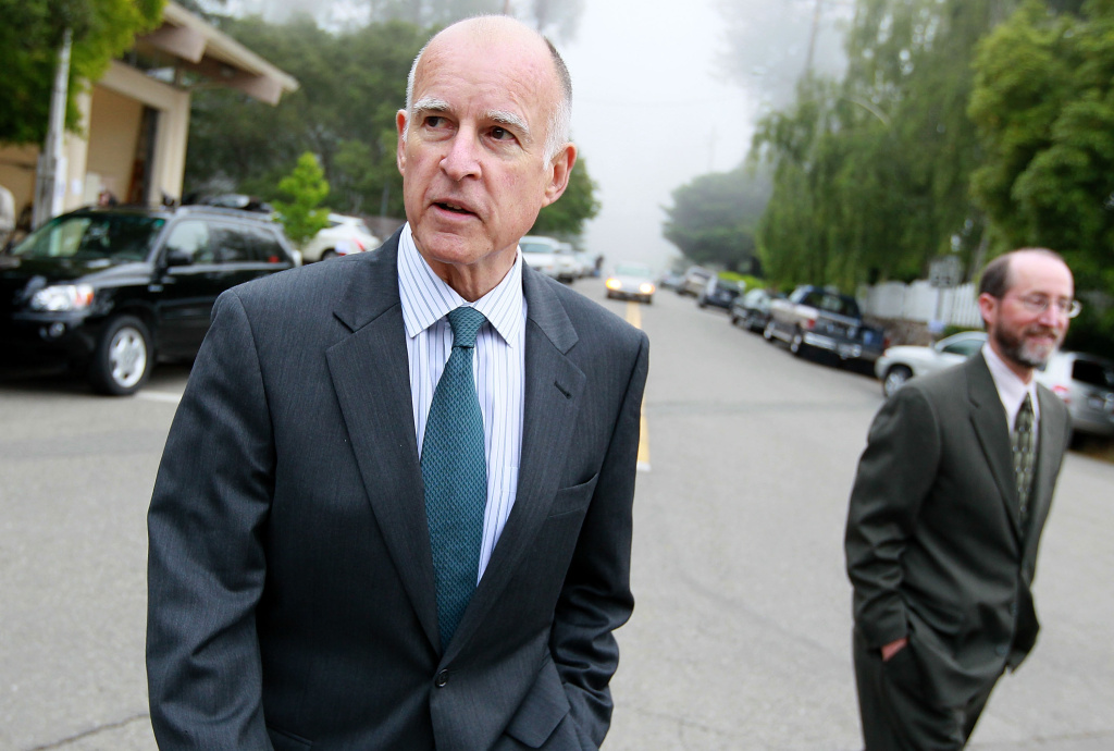 Governor Jerry Brown (L) walks home with his campaign manager Steven Glazer after voting June 8, 2010 in Oakland, California.