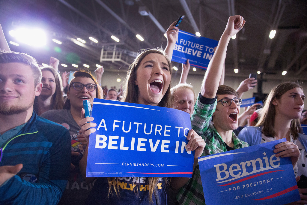 Supporters cheer as Democratic presidential candidate Senator Bernie Sanders (D-VT) arrives to speak at a campaign rally at the Alliant Energy Center on March 26, 2016 in Madison, Wisconsin.