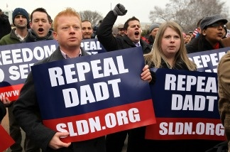 Activists hold signs as they shout slogans during a rally on 'Don't Ask, Don't Tell' on Capitol Hill in Washington, D.C., on Dec. 10, 2010. Servicemembers Legal Defense Network held the rally to call on the Senate to pass the National Defense Authorization Bill that includes the repeal of 'Don't Ask, Don't Tell' which prohibits gay people from serving openly in the military. The House voted 250 to 175 on Dec. 15 2010 to repeal the DADT policy.