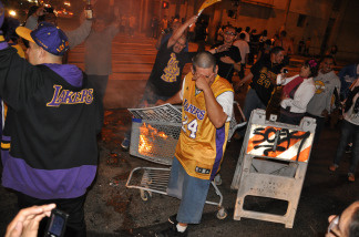 Laker fans start a small fire in the middle of the intersection at Hope St. and 9th St. in Downtown Los Angeles following the Lakers NBA Championship victory over the Boston Celtics on June 17, 2010.